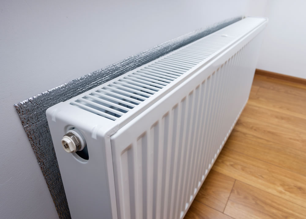 Radiator with foil behind to help heat a room